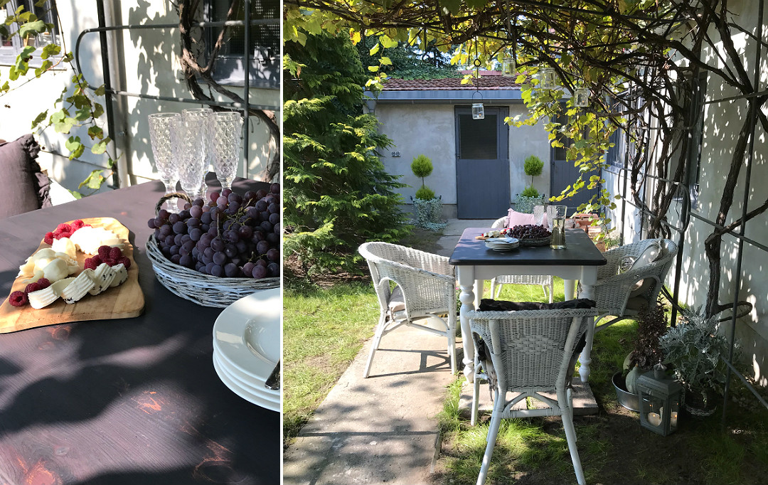 strefa wypoczynku pod pergolą stół pod winogronem