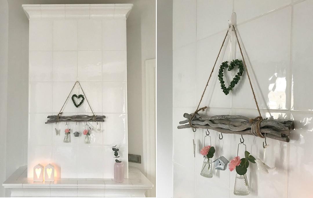 nowy piec kaflowy w starym domu wiosenna dekoracja wieszak z patyków